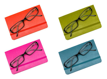 scratchpad: Closed notebook and glasses in set  red, green, pink, blue  isolated on white background