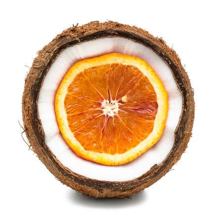 Orange inside coconut isolated on white photo
