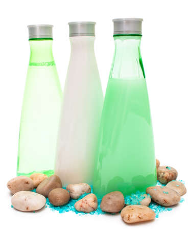 small stones: Spa bottles (green and white) with small stones and sea salt isolated copy space