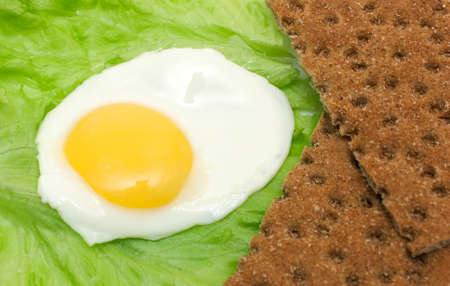 fried eggs: Healthy food background: fried eggs lettuce crisp bread isolated on white