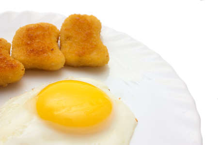 sunny side: Fried egg sunny side up and nuggets copy space isolated on white