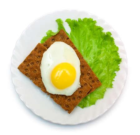 dietetic: Dietetic lunch: fried eggs, lettuce, crisp bread on plate isolated over white Stock Photo