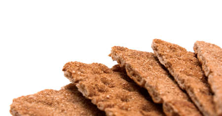 crispbread: Background: crispbread with bran macro copy space isolated over white