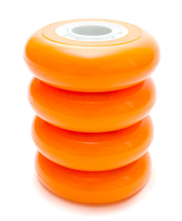 rollerskates: Orange inline rollerskates wheels isolated over white clipping path