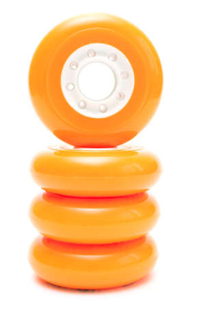 rollerskates: Orange inline rollerskates wheels isolated over white