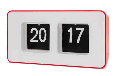 displays: Retro red flip clock displays 2017 year, isolated on white with paths Stock Photo