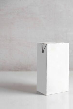 white box of milk on the table Standard-Bild