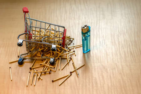 matches and cigarette lighter on the table in the metal basket, cart