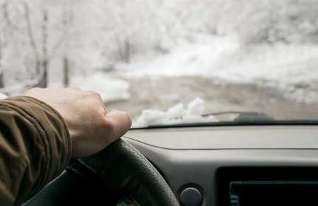 Mans hand on the steering wheel Stock Photo