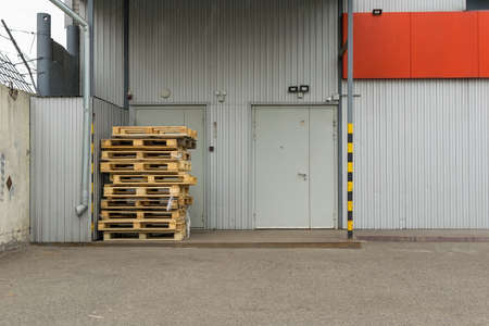 used pallets near the door of the store