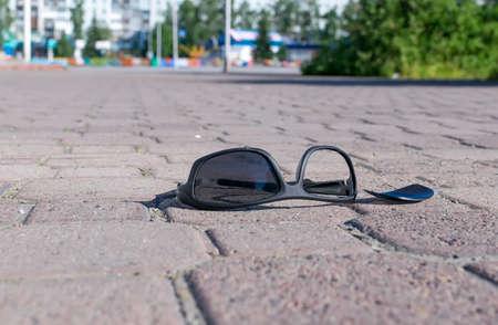 the broken sunglasses