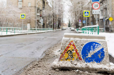 snow-swept road sign