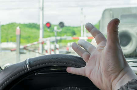 The hand of man inside the car