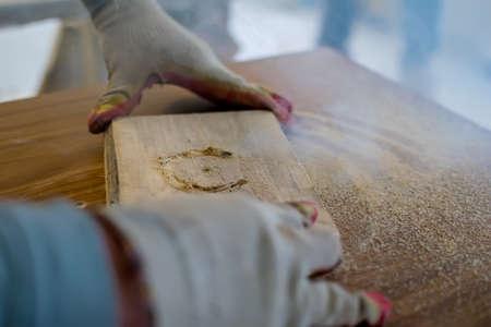 master works on a fraiser machine