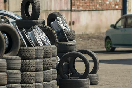 car tires with wheels are sold on the street