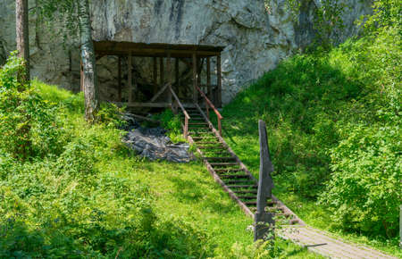 entrance and stairs in ancient stone cave Stok Fotoğraf