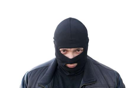 criminal in a black Balaclava on an isolated background Reklamní fotografie