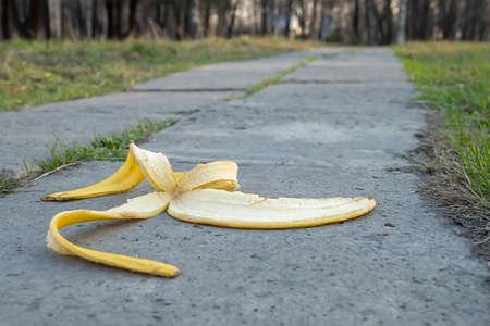 a banana peel lies on a footpath