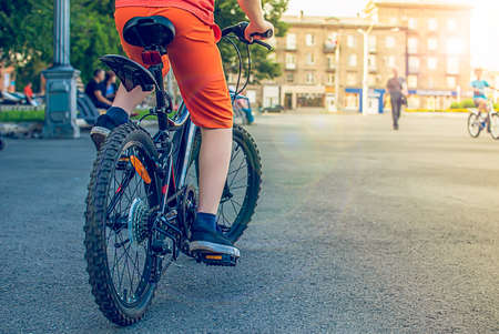 view of children feet on a bicycle Stock Photo
