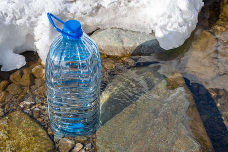 plastic bottle filled with pure life-giving fresh spring water