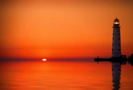 Lighthouse searchlight beam near ocean at sunset Stock Photo