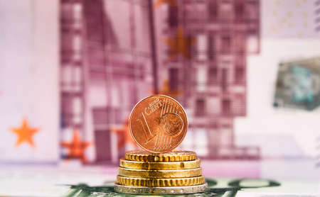 1 Euro cent against 500 Euro banknote, coins and banknotes of the single European currency. Money background. Фото со стока