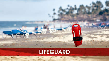 Lifeguard standing in the sand. lifeguard float. Rescue on water.