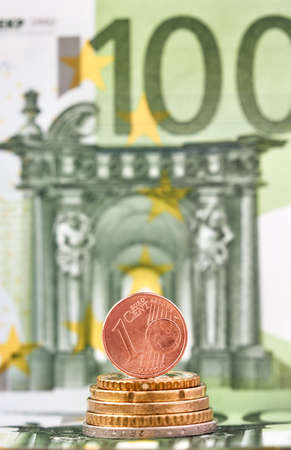1 Euro cent against 100 Euro banknote, coins and banknotes of the single European currency. Money background.