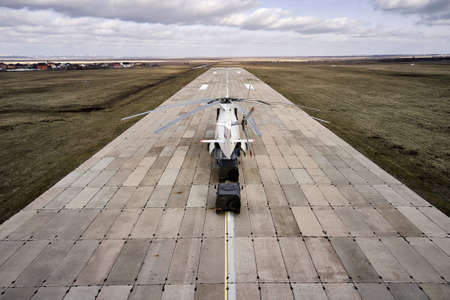 Heavy transport helicopter aerial view. loading equipment on the runway. Reklamní fotografie