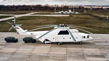 Heavy transport helicopter aerial view. loading equipment on the runway.