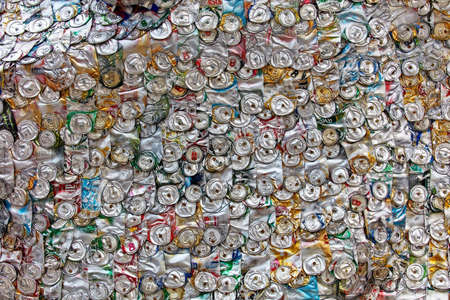 Wall of aluminum cans. Compressed can background close up. aluminum cans. recycling Redakční