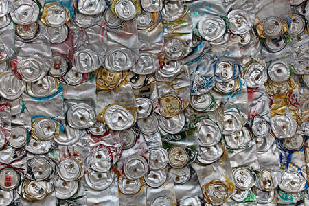 Compressed can background close up. aluminum cans. recycling