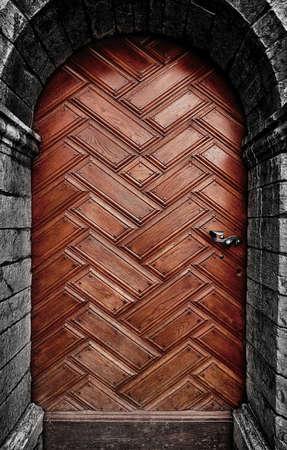 Ancient wooden door, in a medieval castle. Stock Photo
