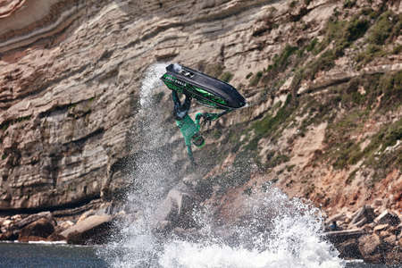 Professional jet ski riders compete at the IFWA World Tour Jet Ski Championship. Contestants perform tricks for judges in the waves. Freeride World Championship IFWA. 27.04.2018, Nazare, Portugal