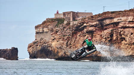 Professional jet ski riders compete at the IFWA World Tour Jet Ski Championship. Contestants perform tricks for judges in the waves. Freeride World Championship IFWA. 27.04.2018, Nazare, Portugal Banque d'images - 139965153