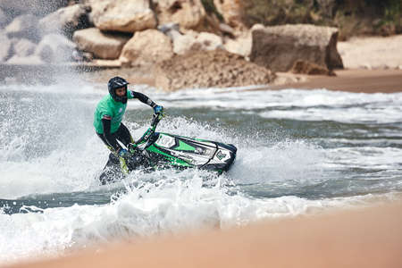 Professional jet ski riders compete at the IFWA World Tour Jet Ski Championship. Contestants perform tricks for judges in the waves. Freeride World Championship IFWA. 27.04.2018, Nazare, Portugal Banque d'images - 139965155
