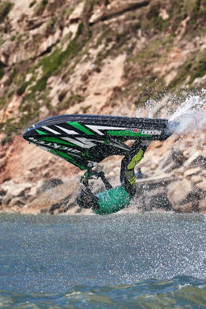 Professional jet ski riders compete at the IFWA World Tour Jet Ski Championship. Contestants perform tricks for judges in the waves. Freeride World Championship IFWA. 27.04.2018, Nazare, Portugal Banque d'images - 139965157
