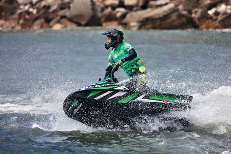 Professional jet ski riders compete at the IFWA World Tour Jet Ski Championship. Contestants perform tricks for judges in the waves. Freeride World Championship IFWA. 27.04.2018, Nazare, Portugal Banque d'images - 139965158