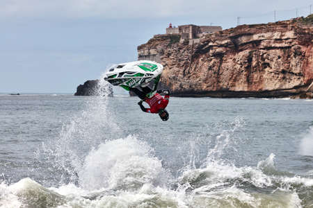 Professional jet ski riders compete at the IFWA World Tour Jet Ski Championship. Contestants perform tricks for judges in the waves. Freeride World Championship IFWA. 27.04.2018, Nazare, Portugal Banque d'images - 139965166
