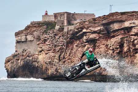 Professional jet ski riders compete at the IFWA World Tour Jet Ski Championship. Contestants perform tricks for judges in the waves. Freeride World Championship IFWA. 27.04.2018, Nazare, Portugal Banque d'images - 139965168