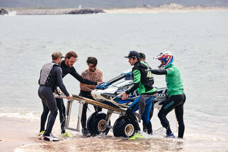 Professional jet ski riders compete at the IFWA World Tour Jet Ski Championship. Contestants perform tricks for judges in the waves. Freeride World Championship IFWA. 27.04.2018, Nazare, Portugal Banque d'images - 139965169