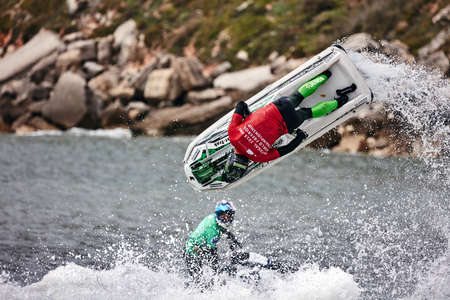Professional jet ski riders compete at the IFWA World Tour Jet Ski Championship. Contestants perform tricks for judges in the waves. Freeride World Championship IFWA. 27.04.2018, Nazare, Portugal Banque d'images - 139965172