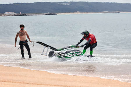 Professional jet ski riders compete at the IFWA World Tour Jet Ski Championship. Contestants perform tricks for judges in the waves. Freeride World Championship IFWA. 27.04.2018, Nazare, Portugal Banque d'images - 139965179
