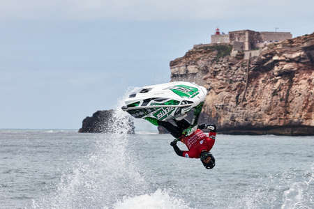 Professional jet ski riders compete at the IFWA World Tour Jet Ski Championship. Contestants perform tricks for judges in the waves. Freeride World Championship IFWA. 27.04.2018, Nazare, Portugal Banque d'images - 139965182