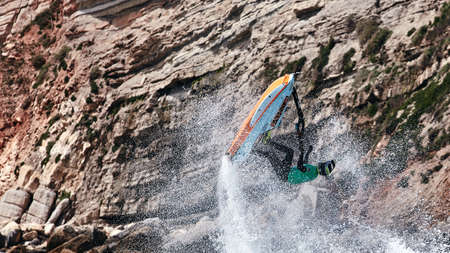 Professional jet ski riders compete at the IFWA World Tour Jet Ski Championship. Contestants perform tricks for judges in the waves. Freeride World Championship IFWA. 27.04.2018, Nazare, Portugal Banque d'images - 139965184