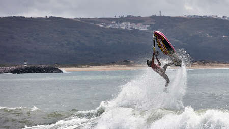 Professional jet ski riders compete at the IFWA World Tour Jet Ski Championship. Contestants perform tricks for judges in the waves. Freeride World Championship IFWA. 27.04.2018, Nazare, Portugal Banque d'images - 139965186