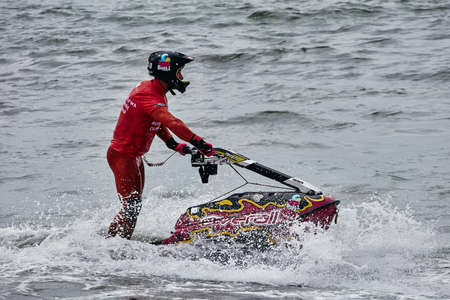 Professional jet ski riders compete at the IFWA World Tour Jet Ski Championship. Contestants perform tricks for judges in the waves. Freeride World Championship IFWA. 27.04.2018, Nazare, Portugal Banque d'images - 139965195