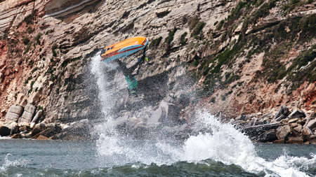 Professional jet ski riders compete at the IFWA World Tour Jet Ski Championship. Contestants perform tricks for judges in the waves. Freeride World Championship IFWA. 27.04.2018, Nazare, Portugal Banque d'images - 139965196