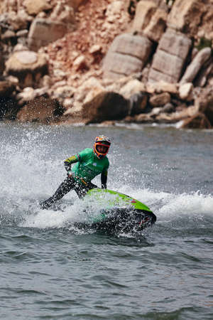 Professional jet ski riders compete at the IFWA World Tour Jet Ski Championship. Contestants perform tricks for judges in the waves. Freeride World Championship IFWA. 27.04.2018, Nazare, Portugal Banque d'images - 139965200