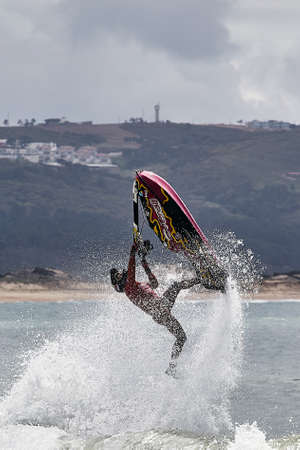 Professional jet ski riders compete at the IFWA World Tour Jet Ski Championship. Contestants perform tricks for judges in the waves. Freeride World Championship IFWA. 27.04.2018, Nazare, Portugal Banque d'images - 139965207